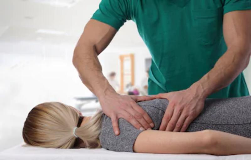 woman-having-chiropractic-back-adjustment-260nw-585638591